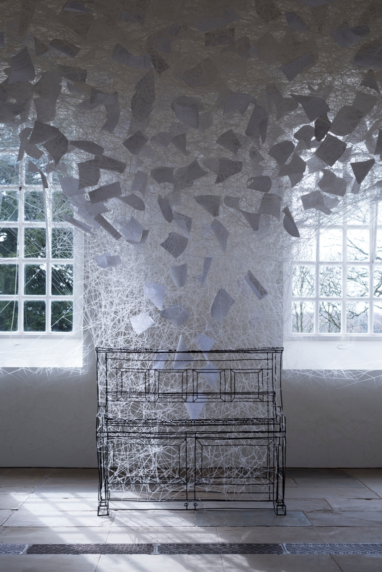 Chiharu Shiota, Beyond Time, 2018. White thread, metal piano, musical notes. Copyright VG Bild-Kunst, Bonn, 2018 and the artist. Courtesy Yorkshire Sculpture Park. Photo © Jonty Wilde